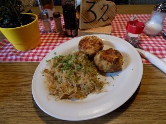 Kasspressknödel (cheese dumplings) with Sauerkraut